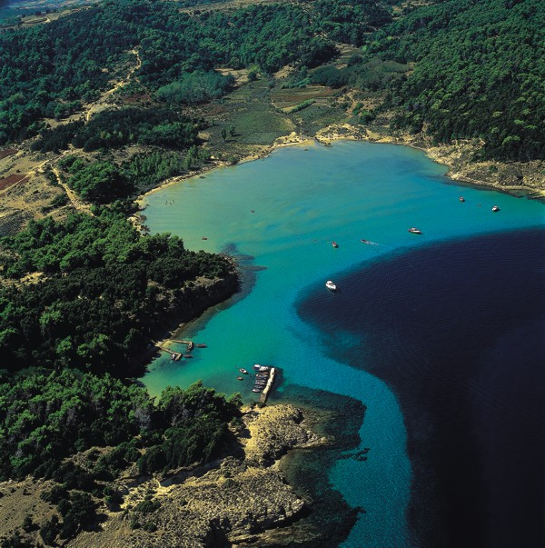 the island rab lopar is blessed with numerous bays sandy and pebly